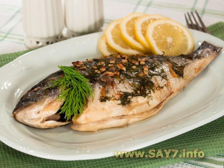 Рецепт Рыба, маринованная в лимоне, запеченная с зеленью и чесноком