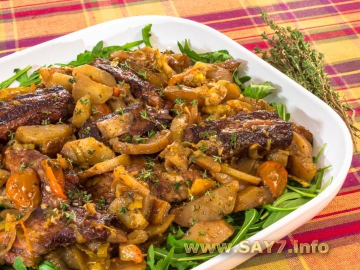 Рецепт Свиные ребрышки, запеченные с овощами