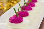 Eggs stuffed with herring and beetroot